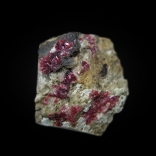 Specimen of acicular pink erythrite Co3(AsO4)2•8H2O and white aragonite CaCO3 crystals on matrix; Gratlspitz, Brixlegg - Rattenberg, Brixlegg - Schwaz area, Inn valley, North Tyrol, Tyrol, Austria; 20 x 17 x 8 mm